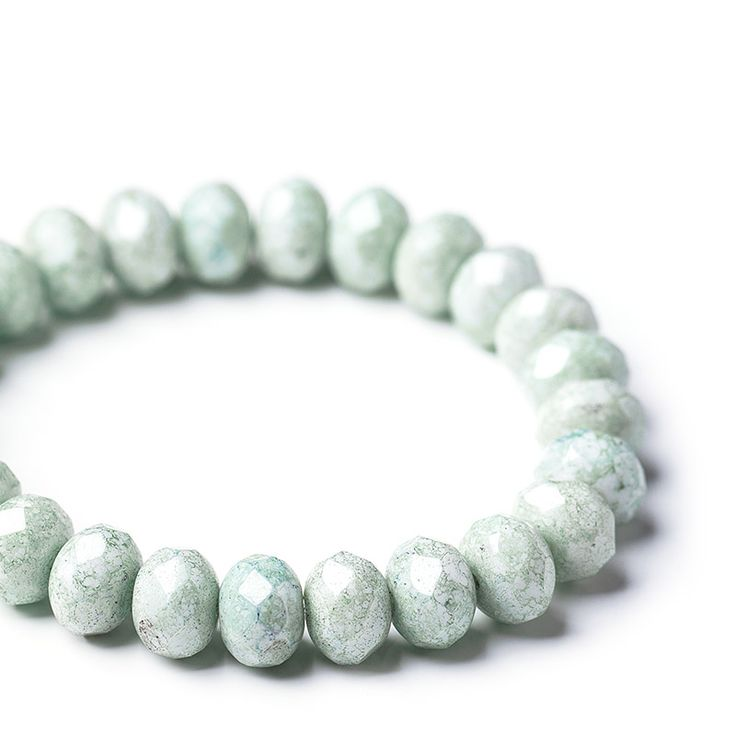 Opaque white fire polished glass spacer beads with pale green marble coating, 6х9 mm