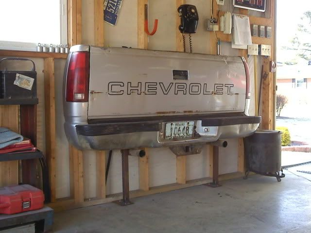 Tail Gate Couch  perfect for in the garage or the barn!  Nothing more fun than sitting on the tail gate drinking a beer.