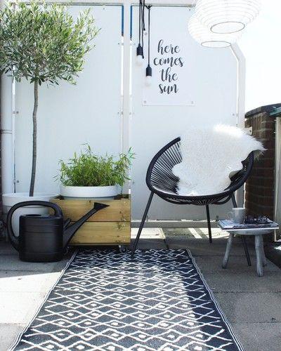 Lounge chair under pergola