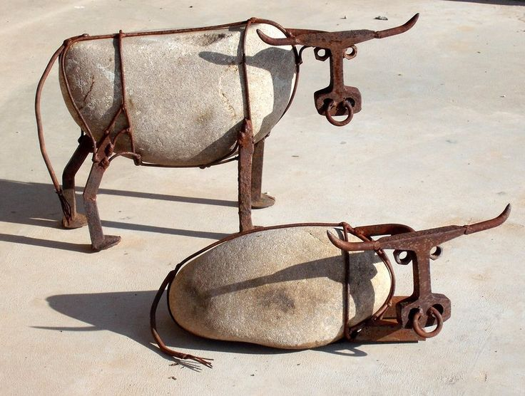 Cattle made from river rock, railroad spikes, railroad track, steel wire, and nuts.