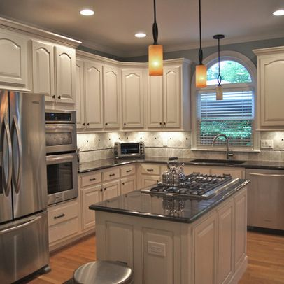 What our kitchen could look like if we keep our cathedral for Black kitchen cabinet doors