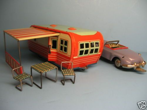 Vintage miniature toy tin trailer, lawn furniture, and car.