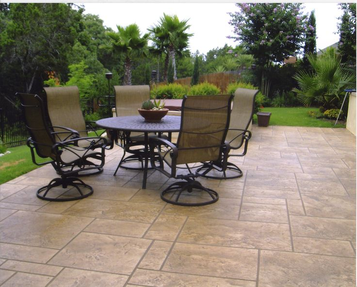 The Fractured Slate And Ashlar Pattern On This Stamped Concrete Patio  Connects It Beautifully With The
