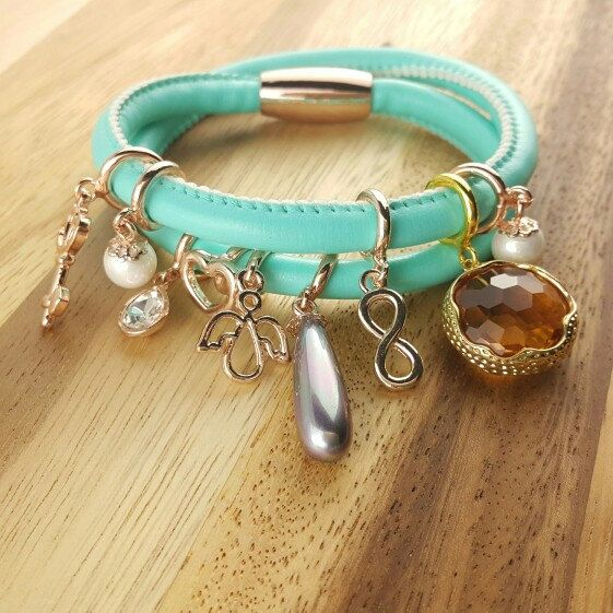 Endless leather bracelet one loop price at 10usd only and variety of charm cubic ,pearl,birthstone starting ar 1.5usd only....the beaty at your choice.