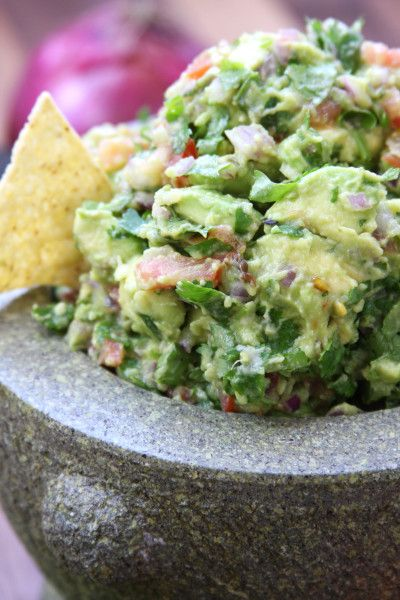 Simple Healthy Guacamole recipe is a fresh, flavorful authentic Mexican dip that has chunky avocados, tomatoes, cilantro. Perfect in tacos or with chips.