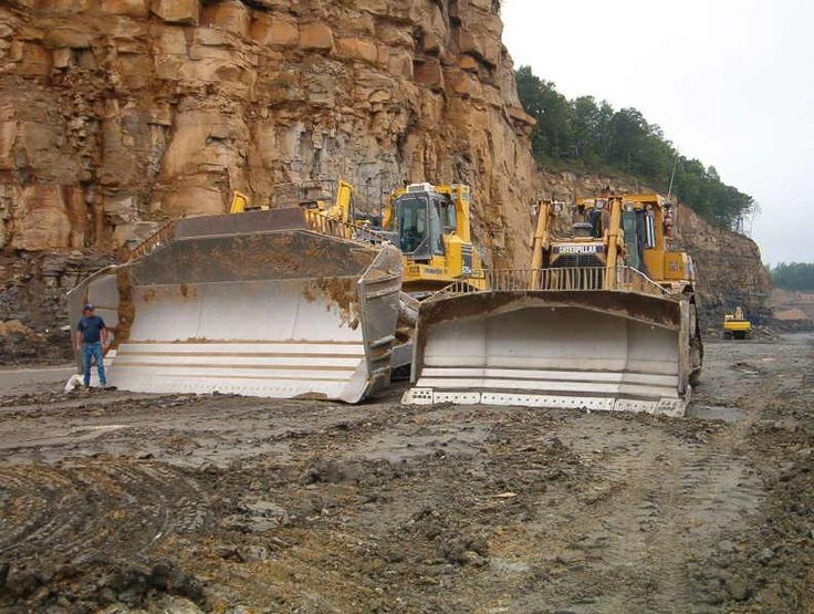 A Komatsu 575 Super Dozer On The Left And A Cat D11 On The