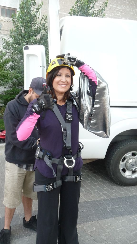 Eva Kovacs from Global TVWinnipeg on Morning News suiting up for rappeling off of Royal Bank building ind downtown Winnipeg to raise money for SMD Foundation