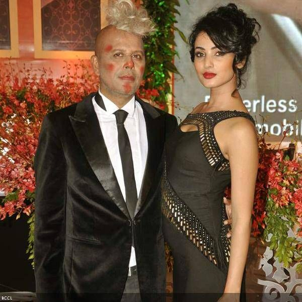 Designer Narendra Kumar Ahmed with B'wood hottie Sonal Chauhan during the launch of his calendar for Swiss airlines, held at Shangri-La Hotel, in Mumbai, on July 17, 2013.