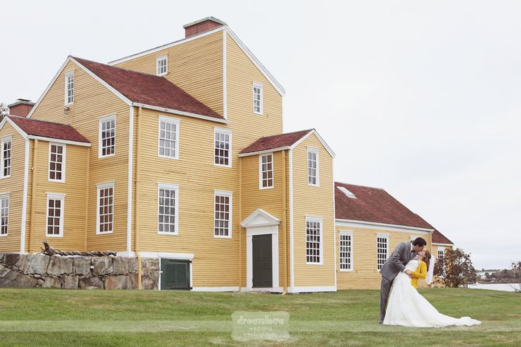 Love this shot of a bride and groom outside of the historic yellow barn at the Wentworth-Coolidge Mansion in Portsmouth, NH.  This lakeside New England wedding venue is secluded, rustic, and lovely!  #wentworthcoolidge #portsmouthwedding #rusticnhwedding #nhweddingvenue