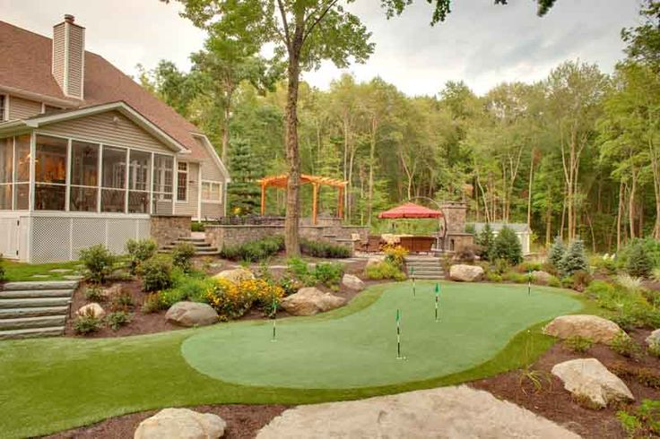 Sloped backyard putting green.