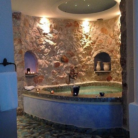 Hand tiled #jacuzzi with lava rocks around and #Swarovski crystals on top! #AstarteSuites #Santorini