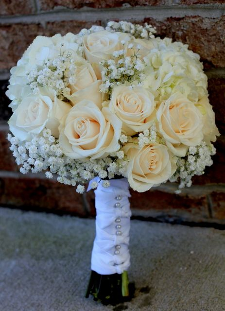 Vendela rose and baby's breath bride bouquet wrapped with white satin. abbadesign.net