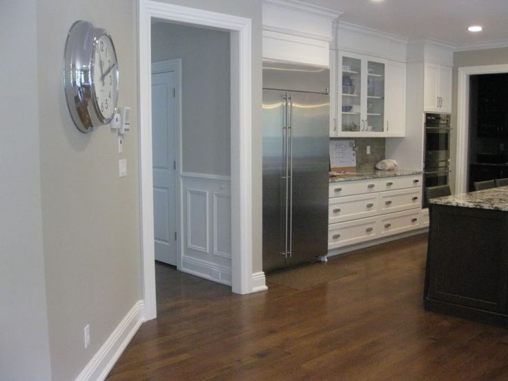 Revere Pewter paint by Benjamin Moore with white paint for cabinets.  I love the silver clock too!!