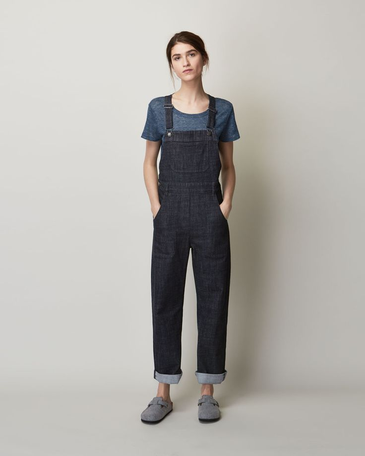Best dungaree in real indigo-dyed, washed cotton denim with 2% stretch. Easy, straight leg. Four pockets in the trouser. One bib pocket. Adjustable straps. Three buttons to fasten right side. Metal fitments. Twin needle topstitching.