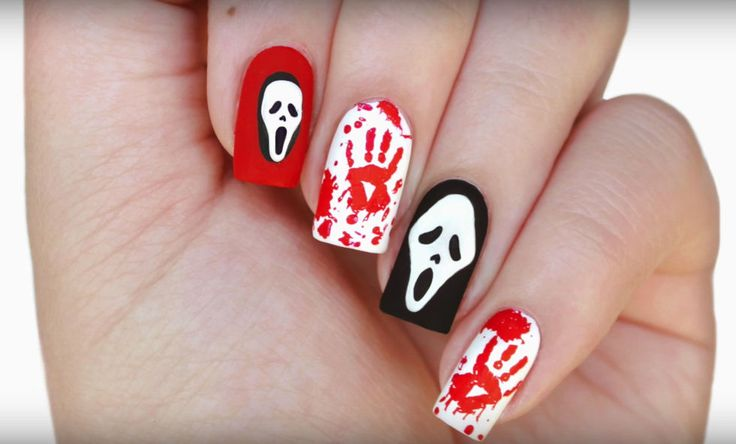 YouTube nail maven JauntyJuli came up with this creepy and yet somehow cute tribute to Scream and its signature scary costume, Ghostface. Get the tutorial on YouTube » What you'll need: nail art brushes ($8; amazon.com)