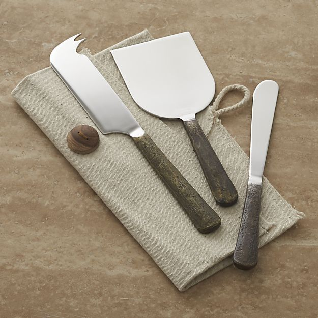 Stainless-steel handles with a distressed, antiqued bronze finish make a rustic serving statement for all types of cheese. Mirror-finish stainless steel cheese knife set includes pronged cheese knife, paddle cutter and spreader.