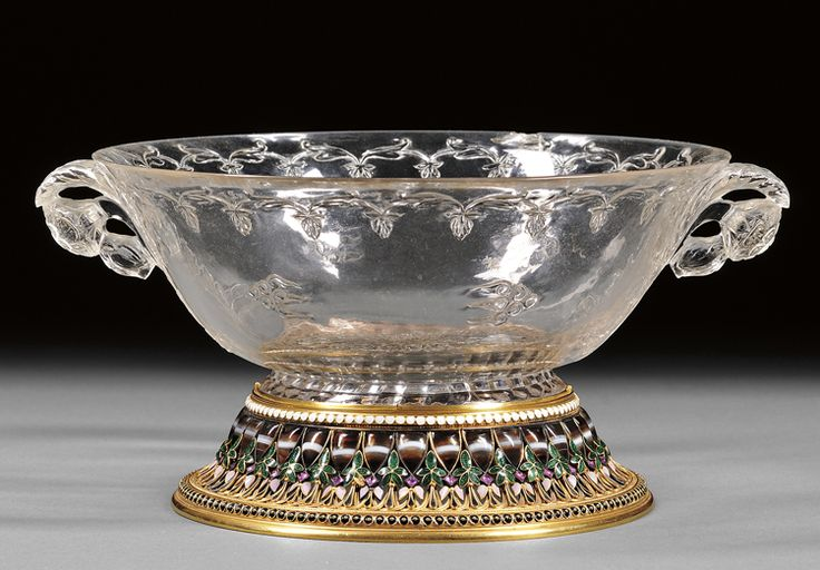 Mughal rock crystal cup. It was most likely made in the 17th/18th century for the ruling court of the Mughal Empire in India, and then embellished in 1867 when the London jeweler Robert Phillips added a delicate gold, enamel and stone mounted foot-rim. Recently sold at auction for over 200K.
