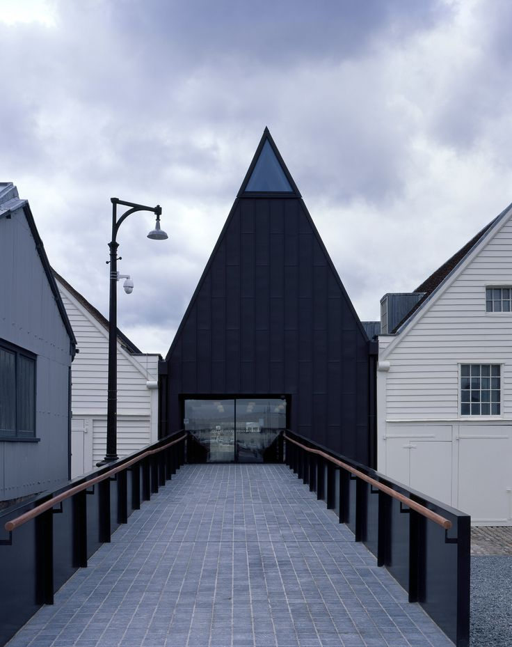 London studio Baynes and Mitchell Architects was employed by Historic Dockyard Chatham to overhaul its site on the River Medway in Kent, creating new galleries for the museum, as well as a new entrance and cafe spaces.