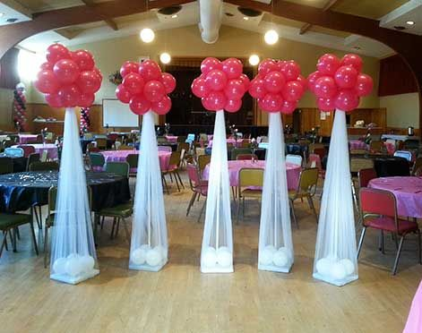 Balloons decorate the entrance of the hall.