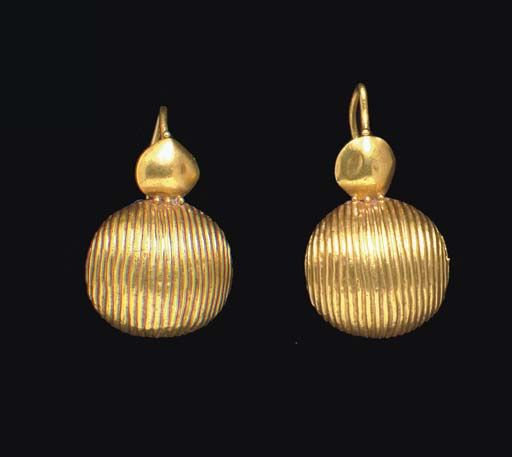 A PAIR OF ROMAN GOLD EARRINGS   CIRCA 1ST CENTURY A.D.   Each with a large ribbed dome, the backing concave and carinated, joined to a smaller shield, granulation around the join, a single granule above, the plain tapering ear hook terminating in a small ball