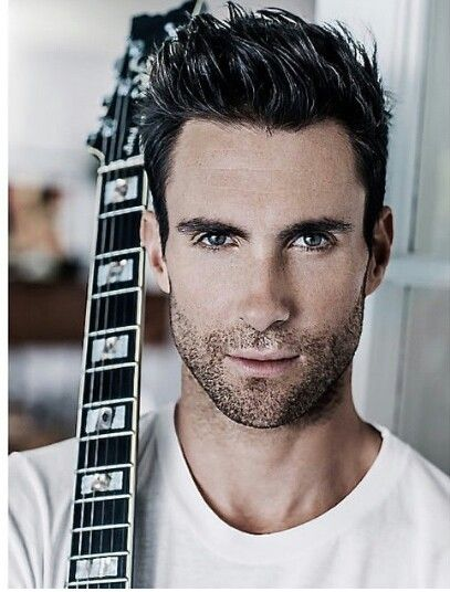Adam Levine. Singer. Man with a guitar. Good looking. What more can a woman ask for?
