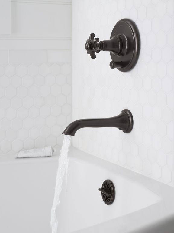Pavilion Black Bathroom details: Oil-rubbed bronze and white hexagon tile.