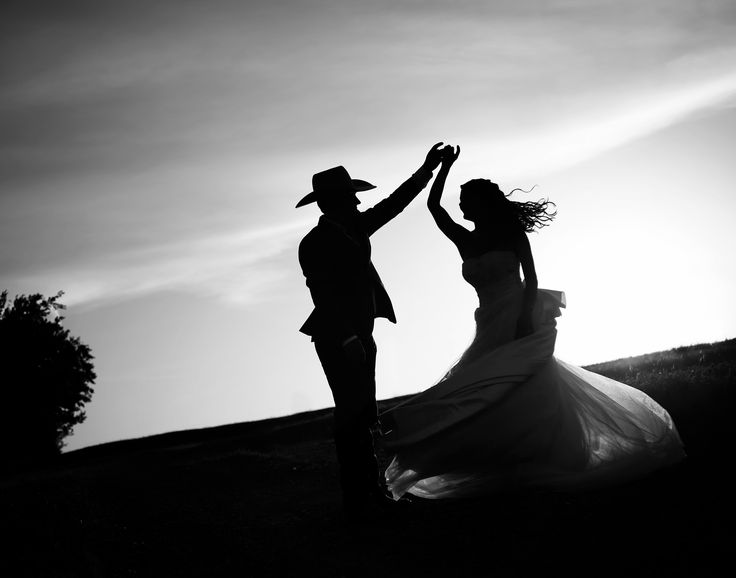 Dancing in the sunset with my new groom; cowboy wedding, silhouette, dancing