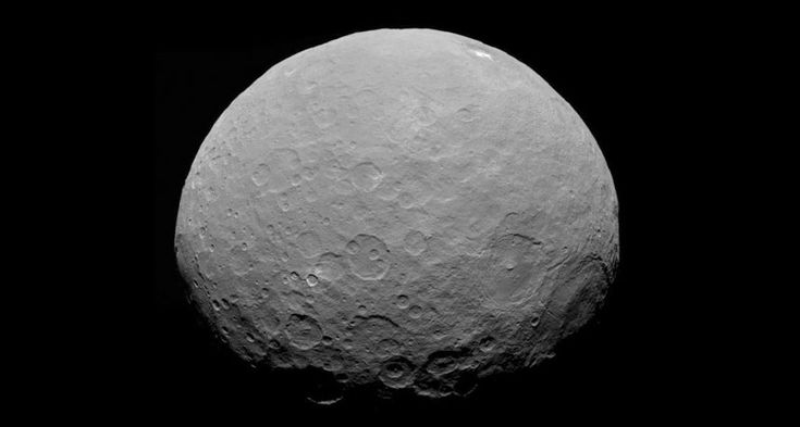 Dawn spacecraft reveals that the dwarf planet Ceres hides a core of solid rock beneath an outer crust of minerals, salts and ices.