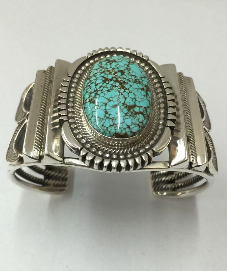 "We specialize in Navajo, Zuni ,and Pueblo Indian handmade goods. Living in Gallup New Mexico makes it convenient to deal directly with our Native American Artists. Amazing hand made Sterling silver cuff bracelet with # 8 turquoise made by Navajo artist derrick Martinez he live in Gallup New Mexico wrist size : 5"" from in side end to end plus gap opining 1.25"" total size 6.25"" width 1.75"" wight : 97.1 gram. 