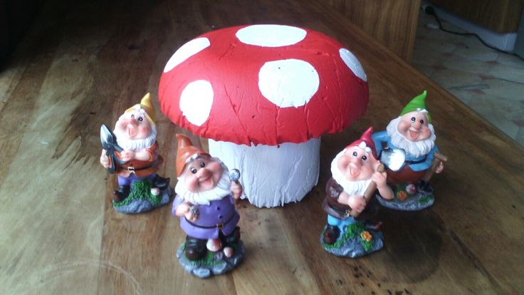 My first attempt at making a concrete toadstool. My gnome friend look very happy with it!