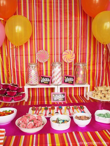 this is supposed to be WONKA - but I like the idea of using wrapping paper or plastic tablecloths to color-up your walls for a party