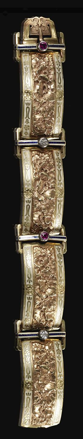 ENAMEL, RUBY AND DIAMOND BRACELET, CIRCA 1920. Decorated with floral motifs within enamel borders, interspersed by circular-cut rubies and diamonds,