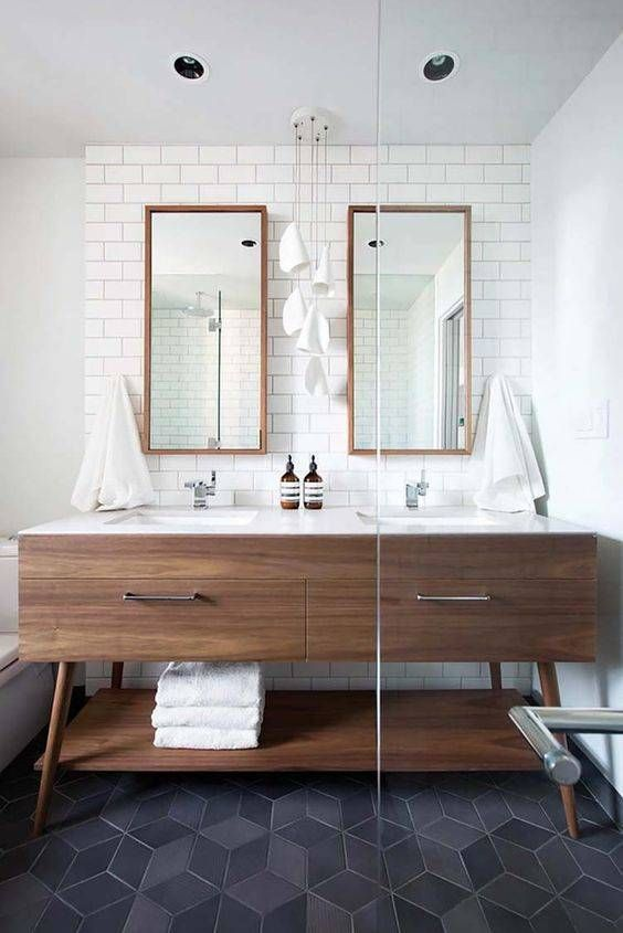 Bathroom with geometric tiled floors and matching mirrors