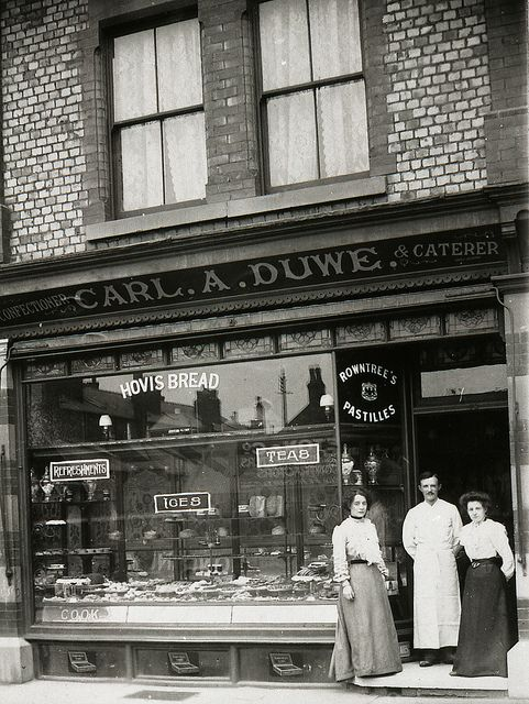 Carl Duwe outside his baker and confectioner's shop on Burton Rd, West Didsbury, 1908