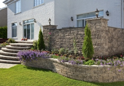 A Raised Patio With Knee Walls Retaining Walls And Raised