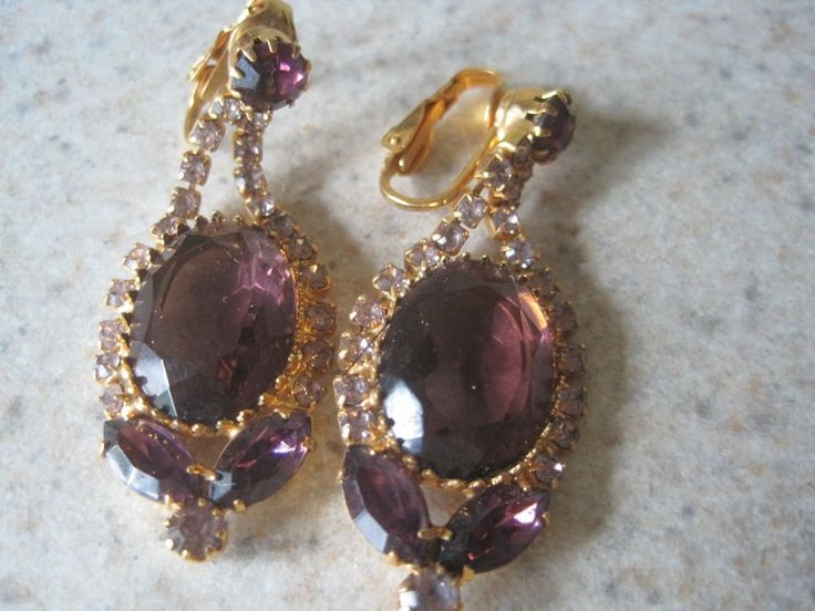 THEY ARE GOLD TONE & AMETHYST COLOR. THIS IS JUST A VERY EYE-CATCHING SET OF EARRINGS. | eBay!