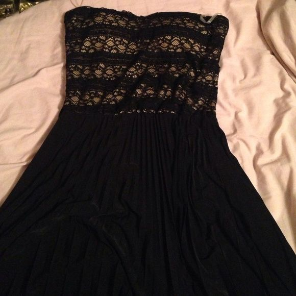 hi low dress this dress is strapless, nude with black lace on top and has a pleated, hi low skirt WINDSOR Dresses High Low
