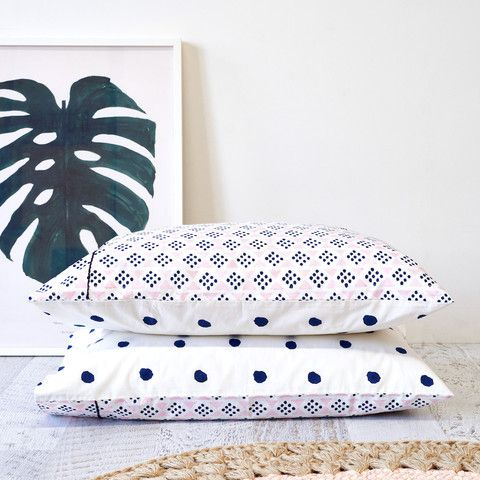 Hand printed tribal and dot standard pillowcase in navy and blush pink with embroidery detail