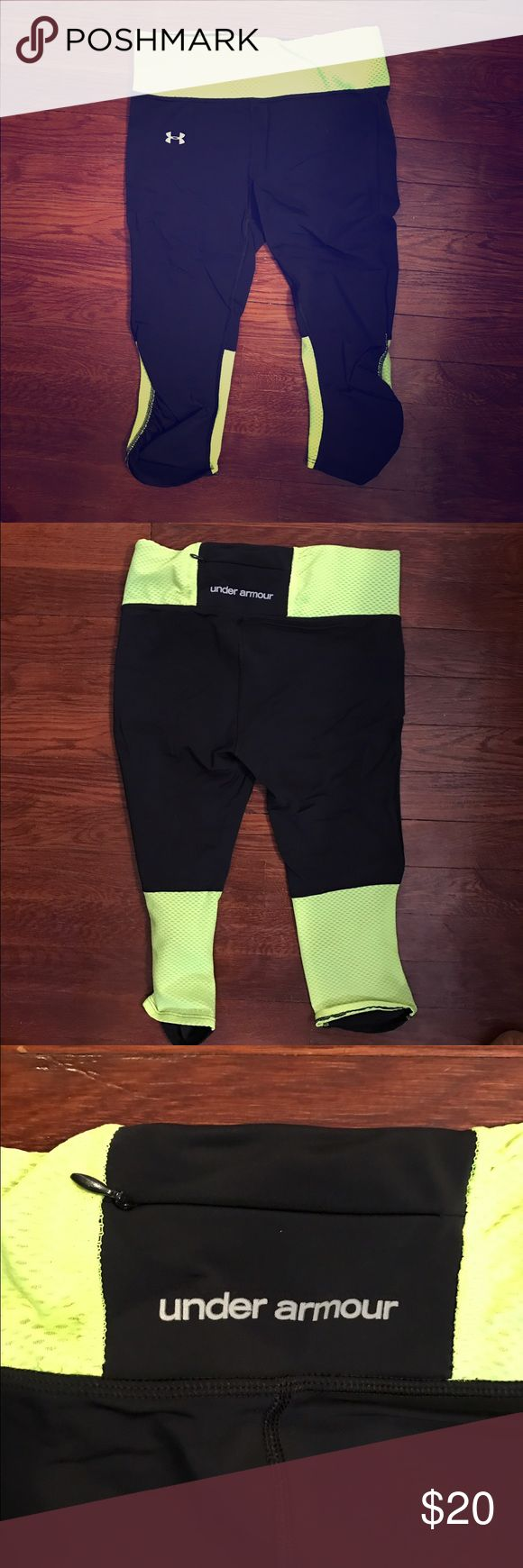 Under Armour cropped pants, size small. Black & neon yellow Under Armour heat gear cropped pants, size small. Back zipper pocket, great for outdoor activity! Under Armour Pants