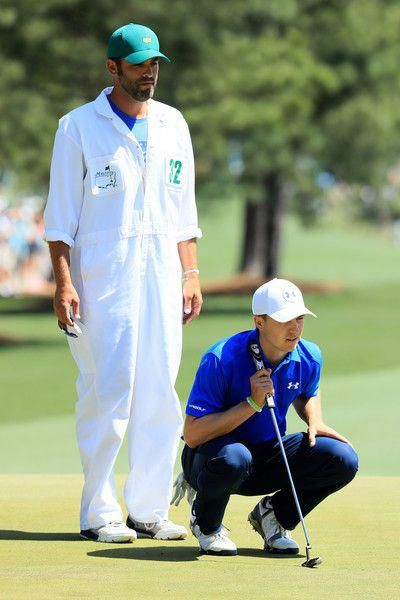 9e1d15c1bd2 Jordan Spieth of the United States lines up a putt on the first hole as  caddie