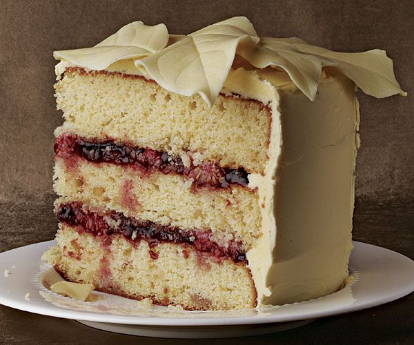 White Chocolate Macadamia Cake with Raspberries and White Chocolate Buttercream  -  White chocolate leaves (surely, it's time to bring them back) and a sleek coat of buttercream give this three-layer stunner a dressed-up look.  -  To get the full recipe, simply click on the photo... ENJOY!