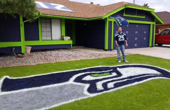 This dude brings new meaning to super fan. He painted his entire house in Seattle Seahawks colors.