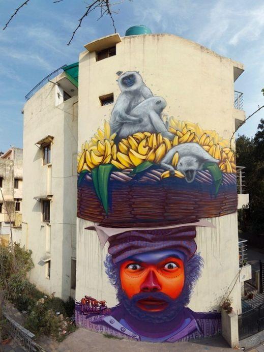 """Serbian street artist Artez's """"Strange Hat"""" mural - New Delhi, India."""
