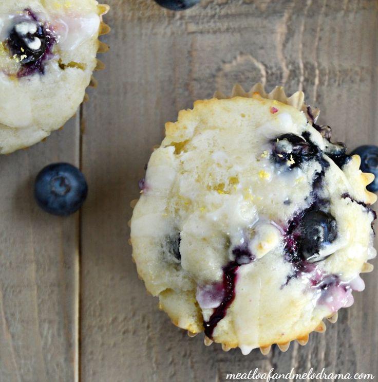 glazed lemon blueberry muffins on wood table