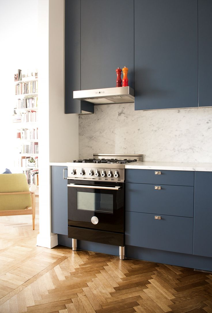 Blue kitchen with carrera marble stone, Bertazzoni oven, herringbone flooring