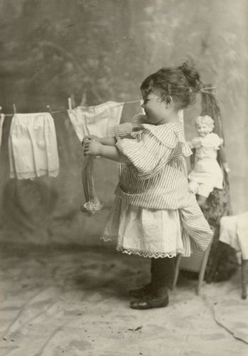 Margery Bish Hanging Clothes on Clothesline  c1890
