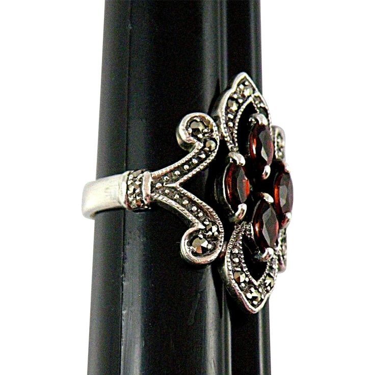 Sterling Silver Filigree Ring with Garnet Glass Crystals Size 6 1/2. Just one of the things on sale at San Marcos on Ruby Lane this week.