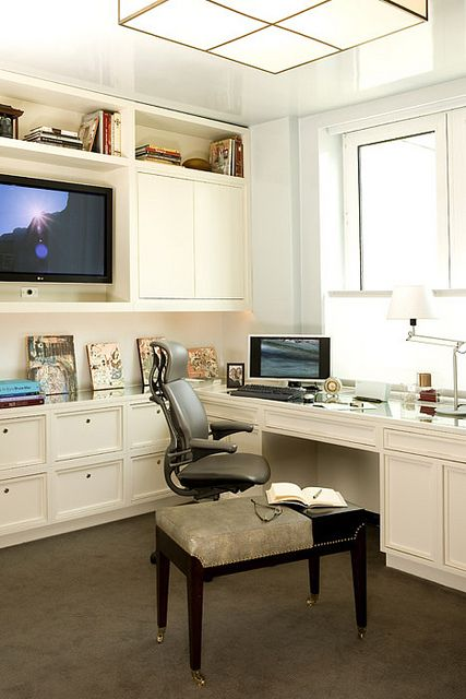Home office. love the storage solution and the t.v. great for a person who works at home but still has to attend conferences...like with a t.v or computer! chic and modern office with plenty of storage!
