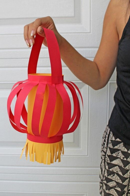 Here's a simple Chinese paper lantern that's made into a round shape.  Directions on how to cut and assemble.  A cute craft for Chinese New Year  China  Lunar New Year