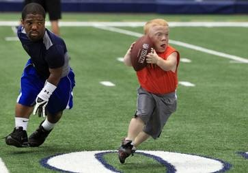 For the nation's little people, a chance to shine on the playing field. More than 200 athletes took part in the Dwarf Athletic Association's National Games in Dallas, including touch football competition at Cowboys' Stadium. My story from The Dallas Morning News, July 2012.